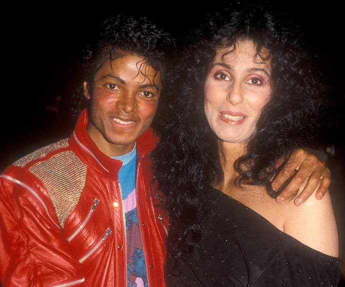 The ultimate powerhouse! Michael Jackson strikes a pose with the *Strong Enough* hitmaker at the *Dreamgirls* opening night in Los Angeles in 1983.