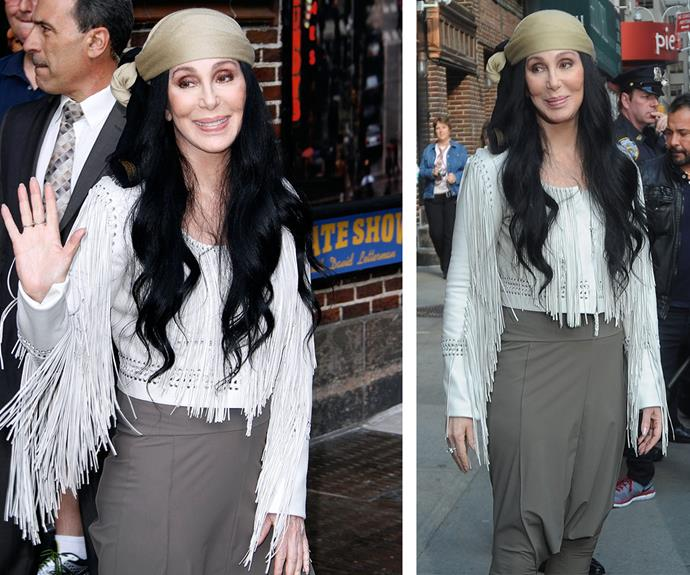 Looking fierce and flawless in a fringed top, high-waisted trousers and a retro bandanna as she leaves the *Late Show with David Letterman* in New York May, 2015.