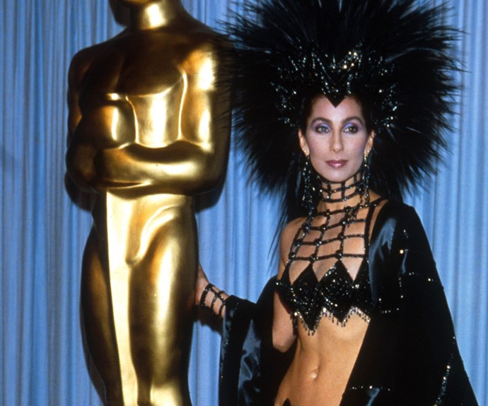 One smouldering pout, plus an epic headdress and a sequinned bralet make for a very eye-catching ensemble at the 1986 Oscars. Bravo Cher, bravo.