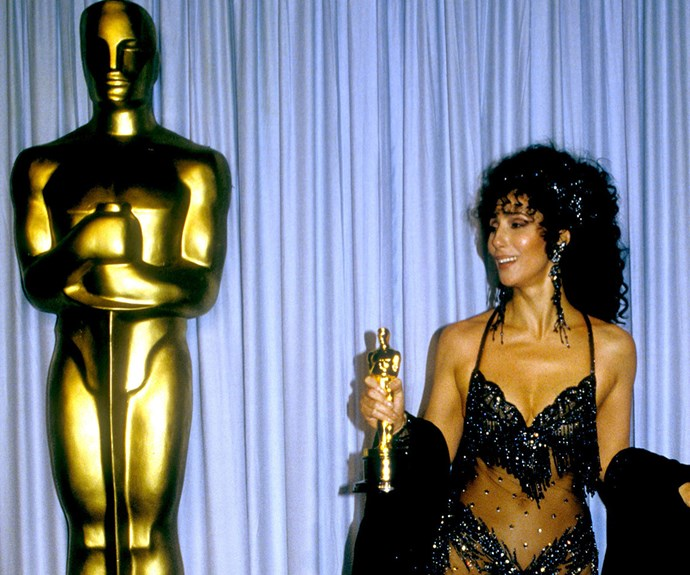 Why wear a boring ball gown when you've got flat abs to show off and Oscars to win? It's 1988 and the trailblazer is rocking  a very revealing number as she bags herself an Academy Award for Best Actress thanks to her portrayal of Loretta Castorini in *Moonstruck.*