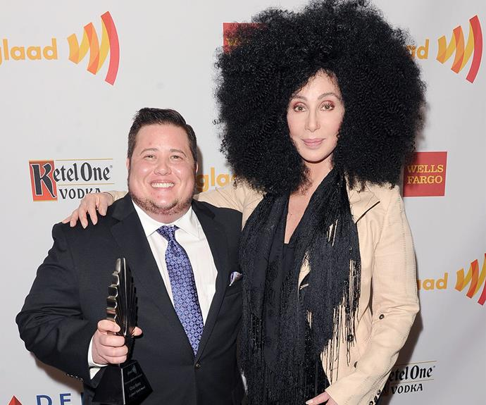 """Cher beams with pride after presenting son Chaz with his GLAAD Award in 2012. The singer has been a pillar of strength throughout Chaz's transition. """"Chaz has the most courage of anyone I know,"""" she has said."""