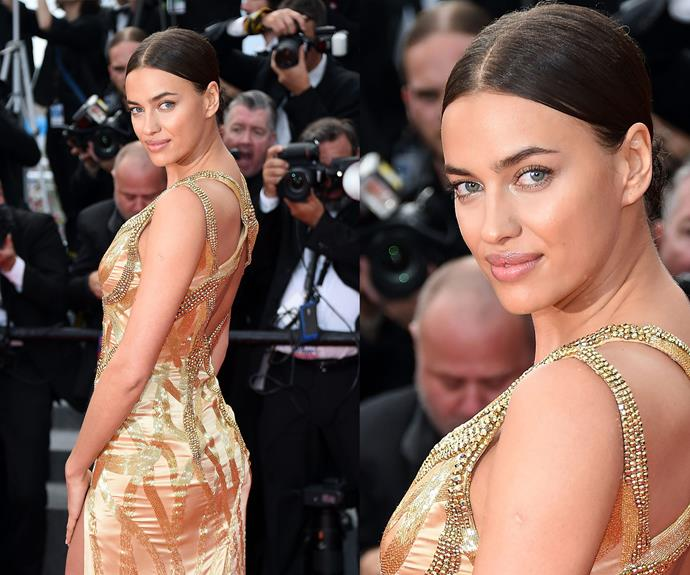 Irina Shayk brings out her inner siren with this sexy fitted gold dress.