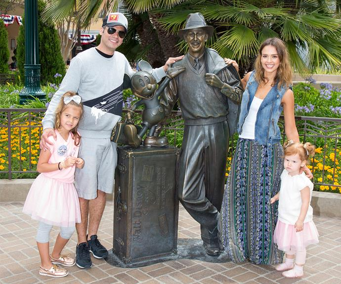 Jessica Alba with hubby Cash and their two girls, Haven and Honor, spending a moment with good ol' Walt himself.