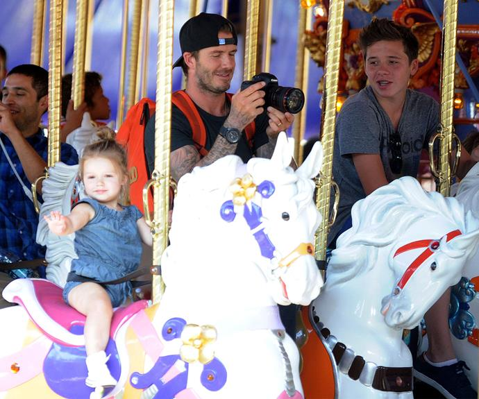 Sometimes something as simple as a merry-go-round can bring joy to you day - even if you're a Beckham!