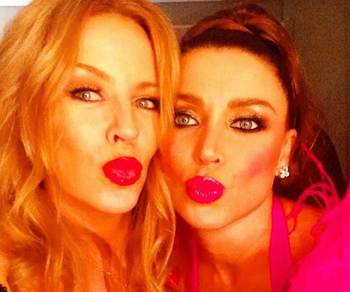 Kylie and Dannii Minogue pucker up at the 2015 Sydney Mardi Gras.