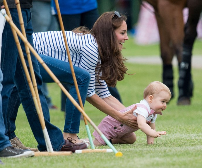 Kate tries to keep up with the tiny tyke as he ventures off for an energetic crawl at the polo.