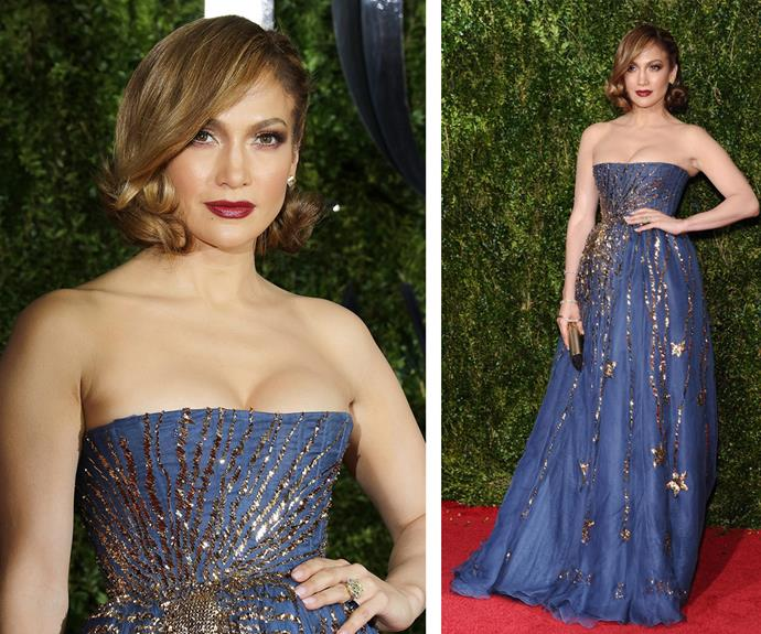 Jennifer Lopez oozed elegance in a strapless Valentino frock with embellished gold detailing.