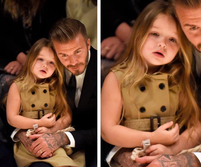 No big deal but here's Harper Beckham sitting front row with dad David and *Vogue* editrix Anna Wintour at the Burberry Fashion show - just another day at the office for this tiny tot.