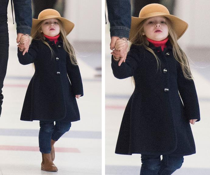 We could only dream of hopping off a long haul flight and looking this fab. The Beckham's only daughter gives serious lessons in style as she lands at JFK airport sporting a floppy felt hat and an A-line trench coat. Does this ensemble come in grown up sizes?
