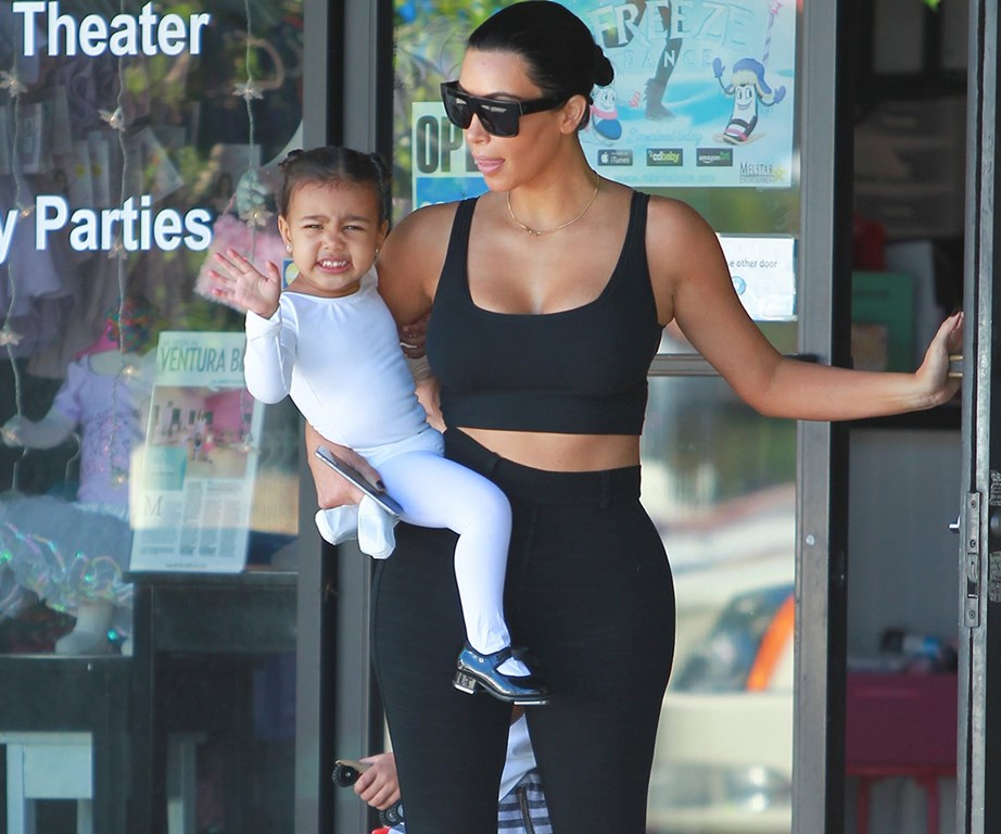 Monochrome magic! Kim and her daughter step out in sleek black and white ensembles as Nori gives a big wave.