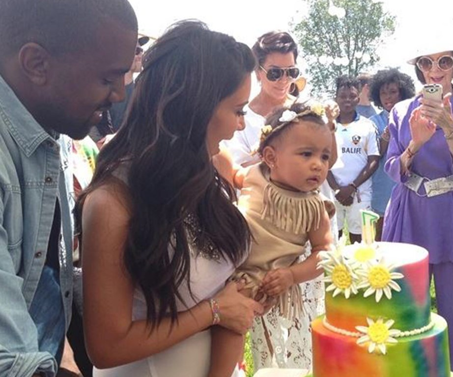 Nori blows out the candles at her Coachella-inspired first birthday party.