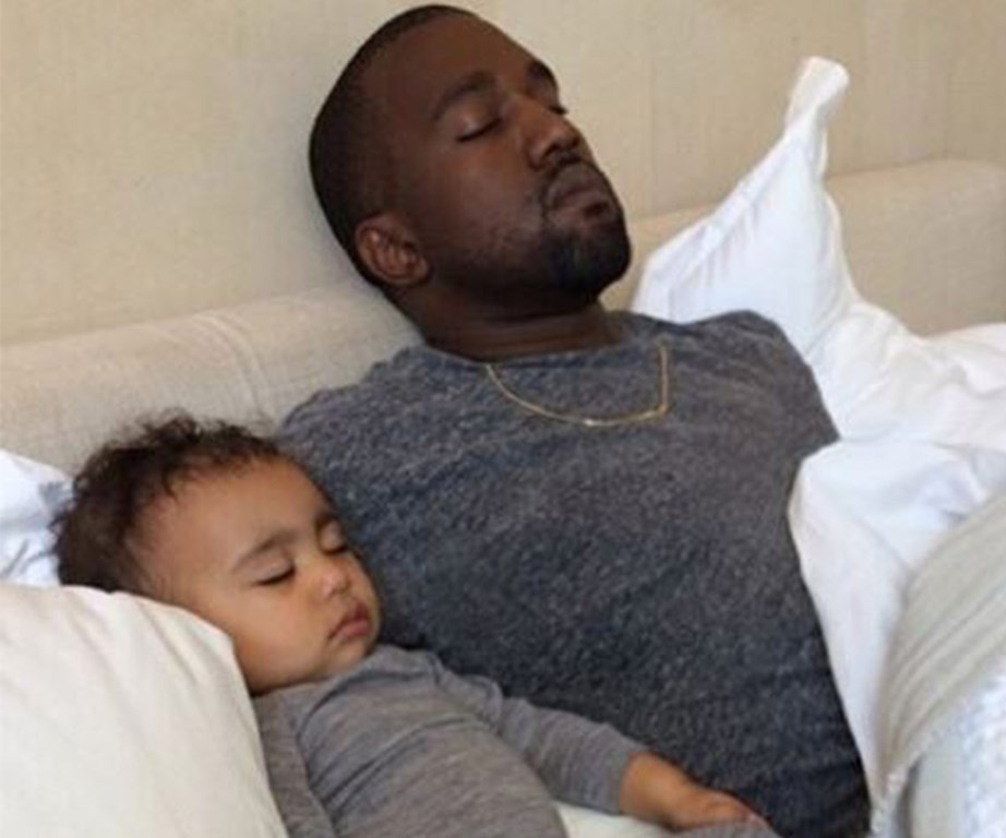 In matching grey marle tops, Kanye and Northie take a nap.