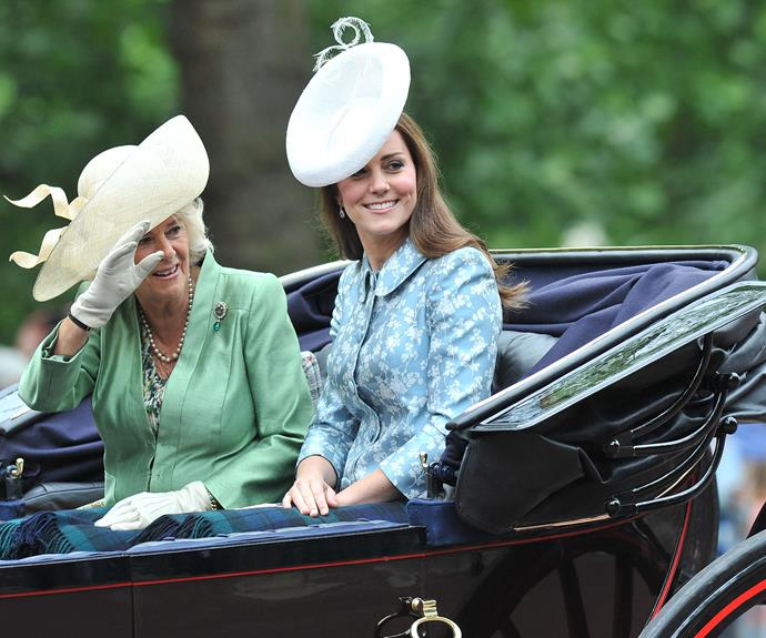 We can't believe how radiant Catherine looks. We adore her choice of outfit, wearing a blue & white coat by Catherine Walker coat and a white hat by London's oldest hatters, Lock Hatters.