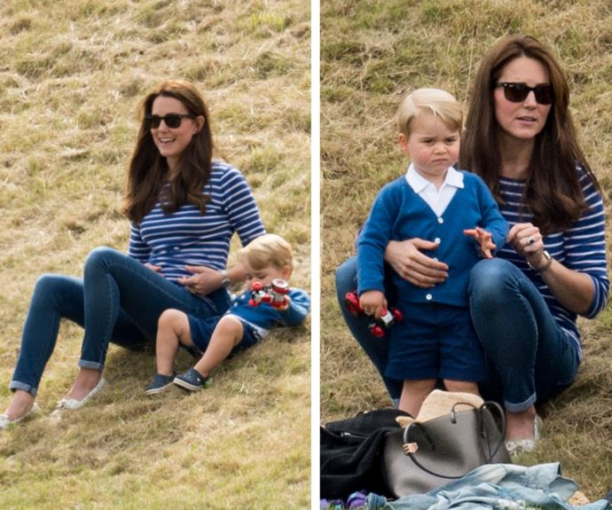 Prince George seemed much more interested in his toy truck and the grassy hill than the match! **Watch George lark about in the next slide. Post continues after the video!**