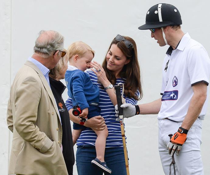 Proud grandfather Prince Charles can't get enough of his first grandson.