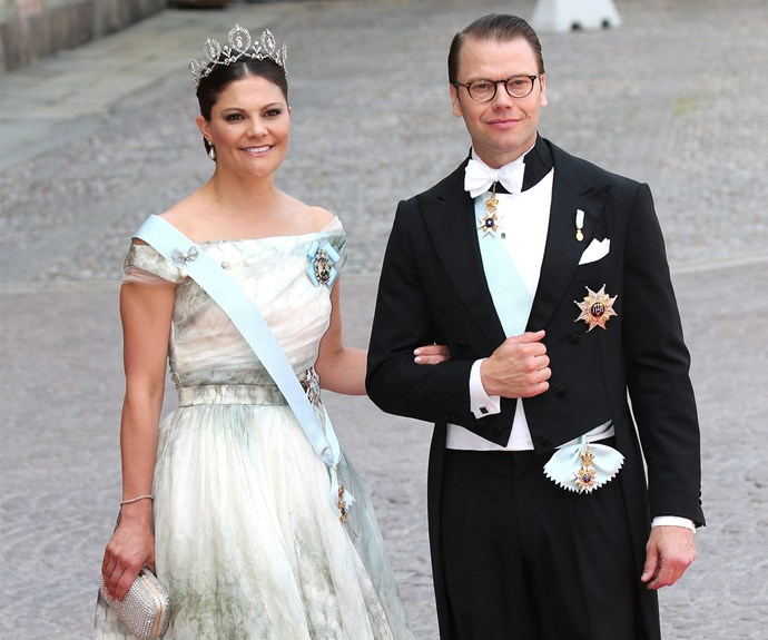Crown Princess Victoria of Sweden radiated as she walked into the ceremony with husband Prince Daniel of Sweden.