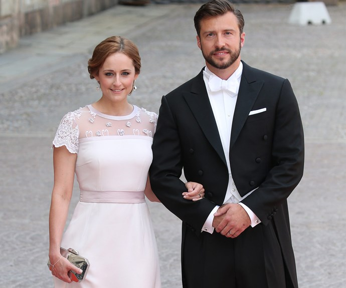 Sofia's sister Lina Hellqvist, pictured with boyfriend Jonas Frejd, kept things classic in a cream frock with lace detailing and a cinched in waist.