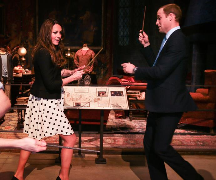 **Working her magic:** In 2013 William and Catherine joked about with their wands as they visited the set of *Harry Potter.*