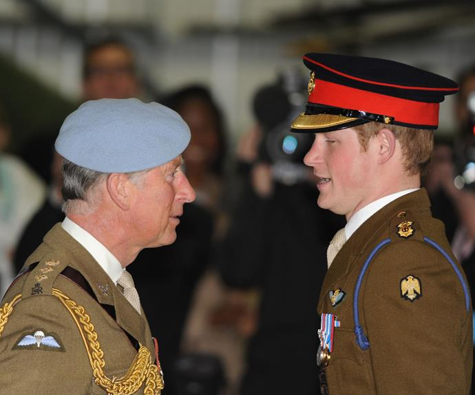 Proud dad moment! Prince Charles presents his son with his flying wings at his pilot's course graduation.