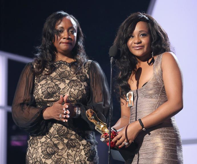 Bobbi Kristina accepts a lifetime award on behalf of her late mother Whitney.