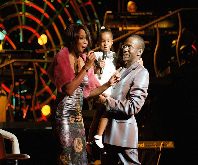 Whitney Houston shares the stage with her daughter and her then-husband Bobby Brown during a concert on July 16, 1999 in New York.