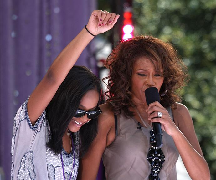 """Bobbi Kristina hits the stage with her mum Whitney Houston back in 2009 at Central Park. After Whitney's death, Bobbi told Oprah: """"I've got to keep going. My family [are keeping me going] and The Lord and her [Whitney]... hearing her all the time. Her spirit is strong."""""""