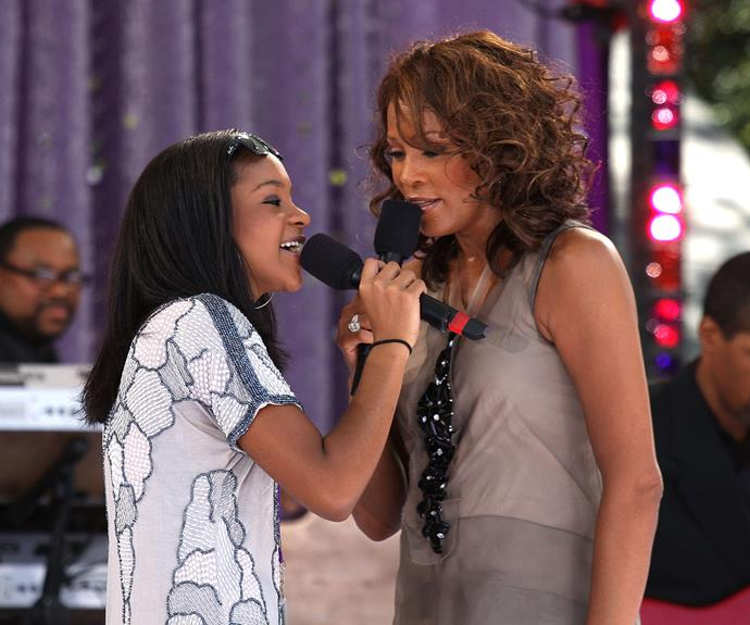Bobbi and Whitney perform *My Love is Your Love* together.