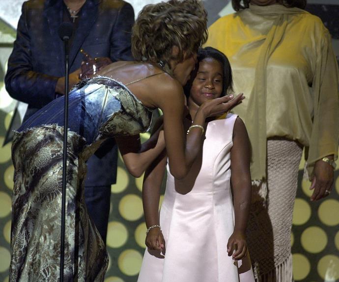 Whitney Houston kisses her daughter Bobbi Kristina during the 1st Annual BET Awards in 2001.