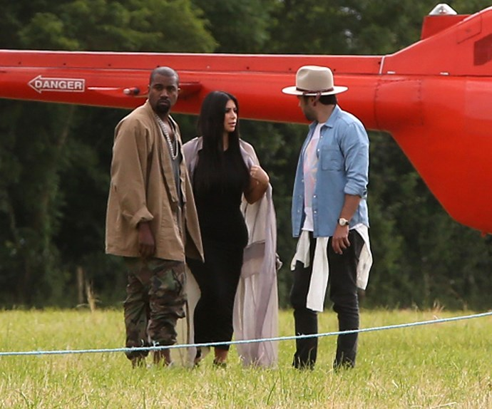 Kim Kardashian and Kanye West were not interested in the soggy ground of Glastonbury, as they made their entrance via helicopter.