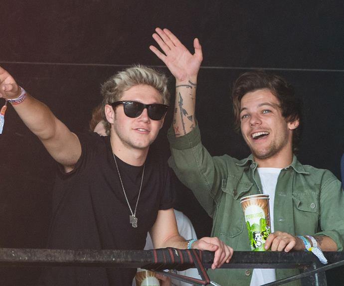 What's a party without the boys of *One Direction*? Louis Tomlinson and Niall Horan enjoy themselves from the VIP area