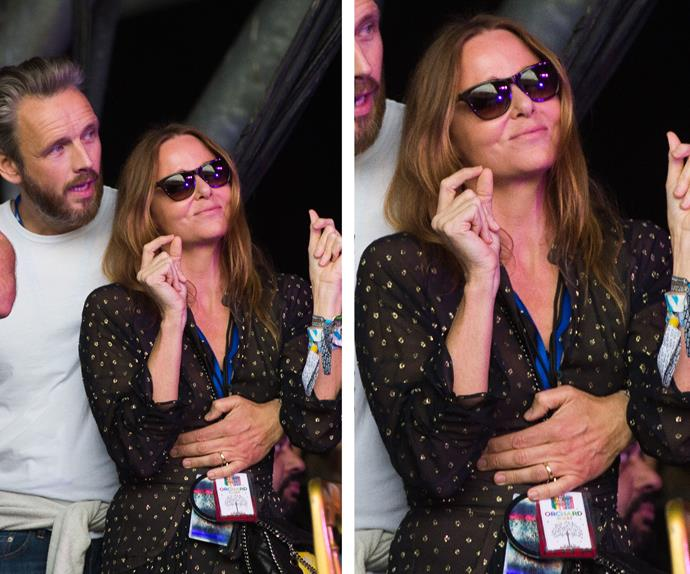 Stella McCartney looked at home in her husband's arms dancing on the sidelines of Glastonbury.