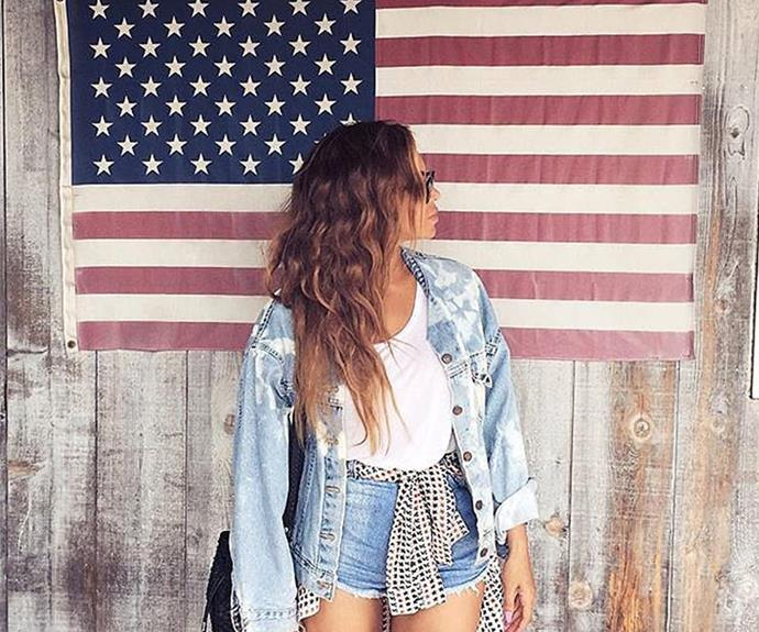 Beyoncé showed off her patriotic side with a douse of double denim as she posed behind the American flag.