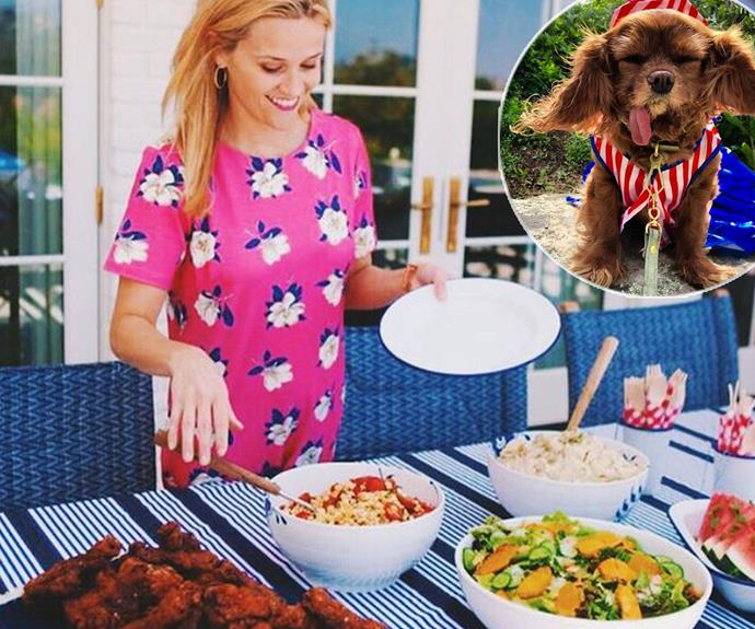 Southern Belle Reese Witherspoon was the hostess with the mostest serving up an epic smorgasbord of deliciousness. We are eyeing that fried chicken!  She also shared a snap of this little guy, working his red, white and blue like nobody's business! We give him two woofs.