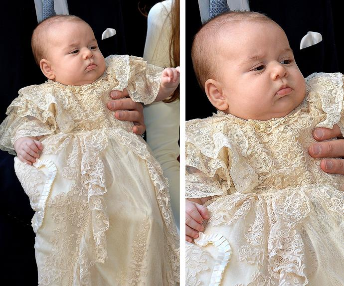 """Tell me why am I in this long frilly gown?"" The cherubic bub gives epic side-eye at his 2013 christening."