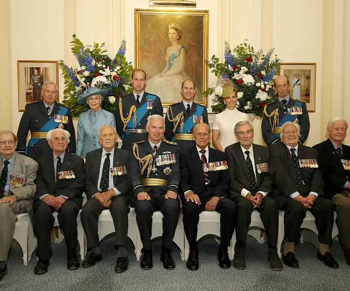Say cheese! Prince Philip summons a smile through gritted teeth.