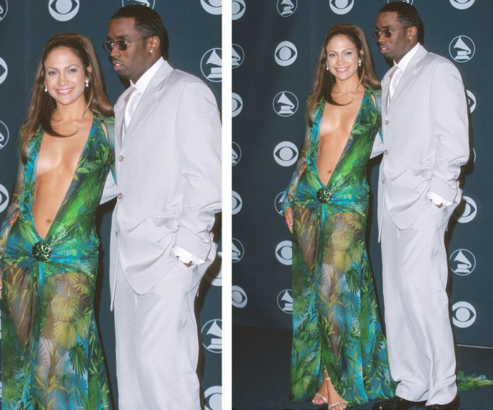 """""""It didn't seem that out there to me. It was a good-looking dress. I had no idea it was going to be such a big deal,"""" JLo, pictured with her then boyfriend Puff Daddy, later reflected to *People* of her headline-grabbing outfit."""