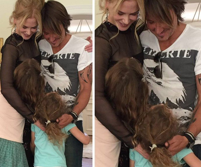 Nicole and Keith cuddle up to their two girls, Sunny and FiFi.