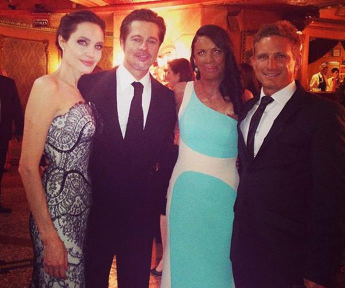 Pictured with Brad Pitt and Angelina Jolie at the *Unbroken* premiere in Sydney in 2014.