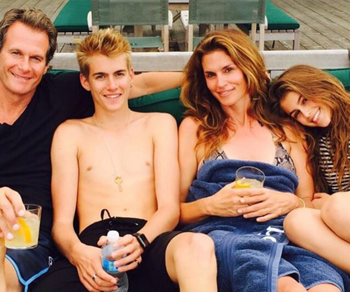 Cindy Crawford with her model family. You'd be forgiven if you confused this portrait for a Polo Ralph Lauren ad! Hubby Rande, son Presley and her mini-me Kaia enjoyed a dip in the lake.