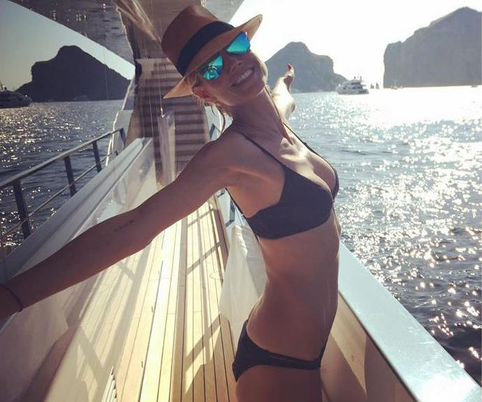 What's your secret? Heidi Klum, 42, stuns in a chic bikini as she soaks up the vitamin D!