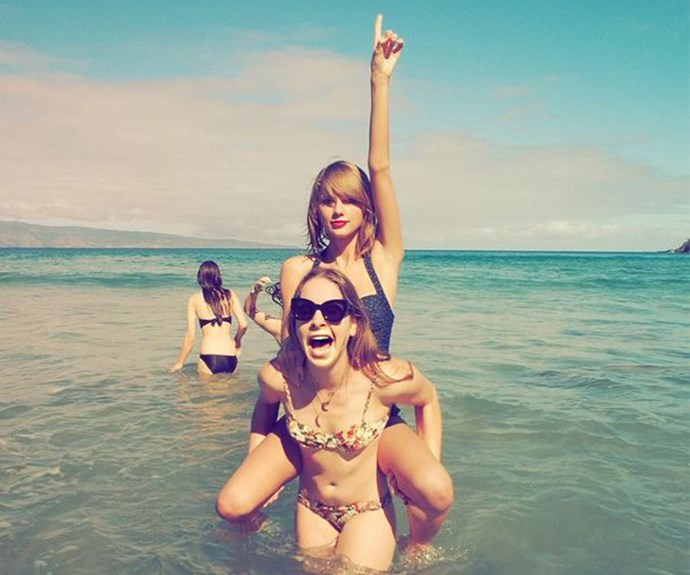 Taylor makes a swift line to the ocean. She may sing about bad blood but she can't get enough fun times in the sun with her girls.