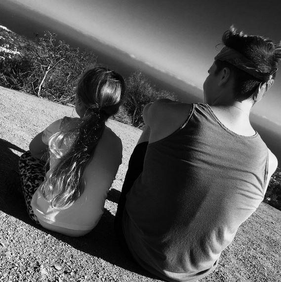 """Fun hiking with my baby sis,"" 16-year-old Brooklyn wrote alongside this black and white snap with his only sister. It looks like the aspiring model is showing Harper how to love the outdoors!"