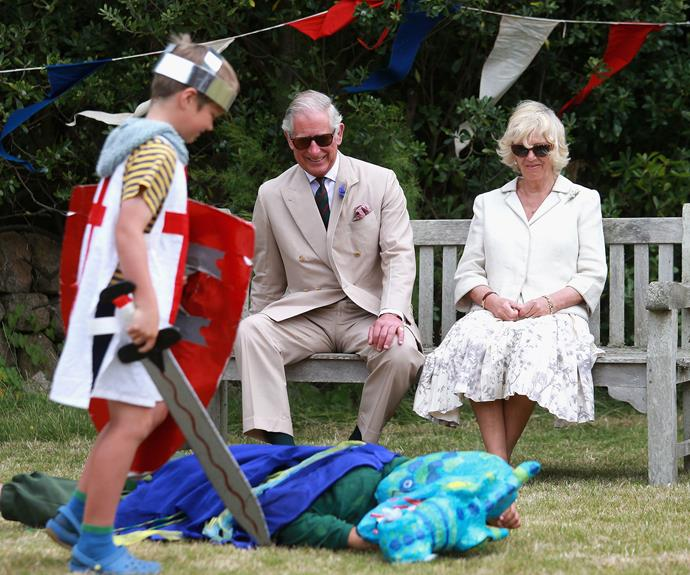 We are unsure if Charles is laughing at the pantomime or the fact that the kid is wearing Crocs? Either way, the duo look tickled pink during their visit to the UK's Isles of Scilly in July this year.