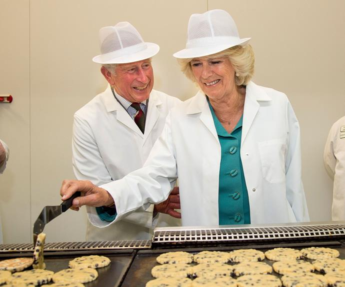 One is quite amused at Camilla trying to bake! The pair get overcome with the giggles during a factory visit.