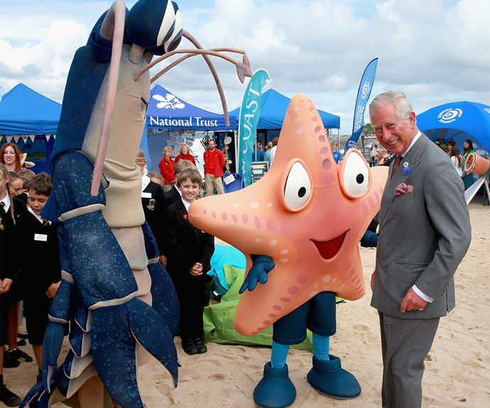 Charles chuckles with his new mate, Larry the Lobster, during a trip to Fistral Beach in Cornwall.