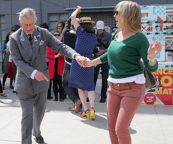 And Charles certainly isn't afraid to get low and bust out some moves with well-wishers.