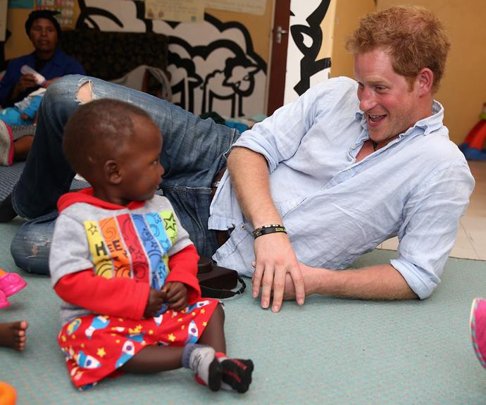 His love of children would make anyone smile.