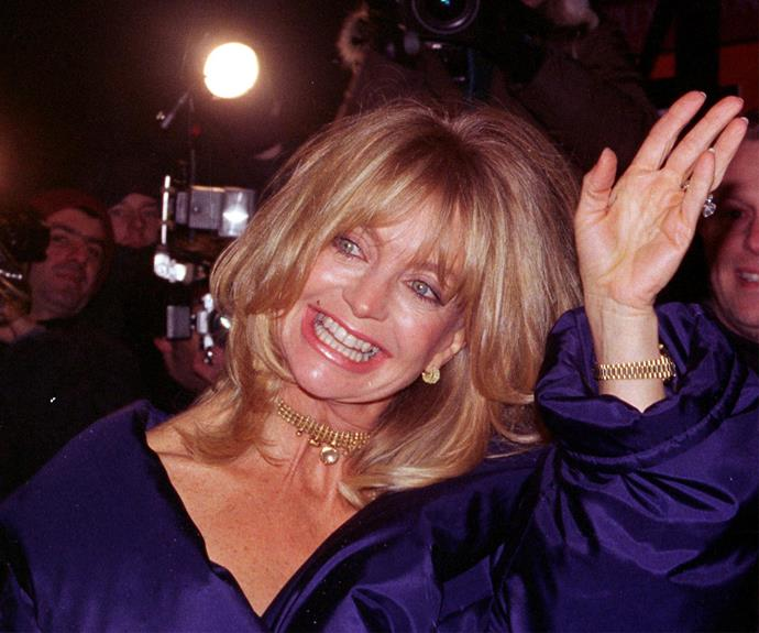 Lefties run in the family. Goldie Hawn uses her southpaw.