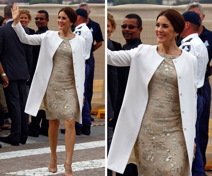 Welcome home! This was just one of the gorgeous outfits Mary wore on her trip to Sydney in 2013 – the city she met the love of her life Prince Frederik. The flirty hemline of the embellished beige frock perfectly showcases her trim pins.