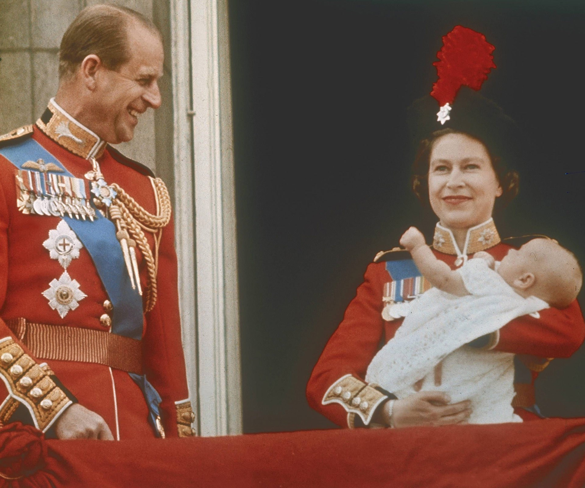 Prince Philip watched his wife fondly as she presented the world her newborn son, Prince Andrew for his first appearance on Buckingham Palace's balcony at Trooping the Colour in 1961.